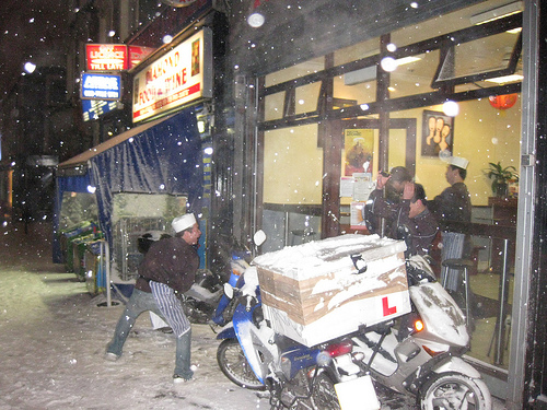 Some cooks start a little snowball fight at a Haverstock Hill take away